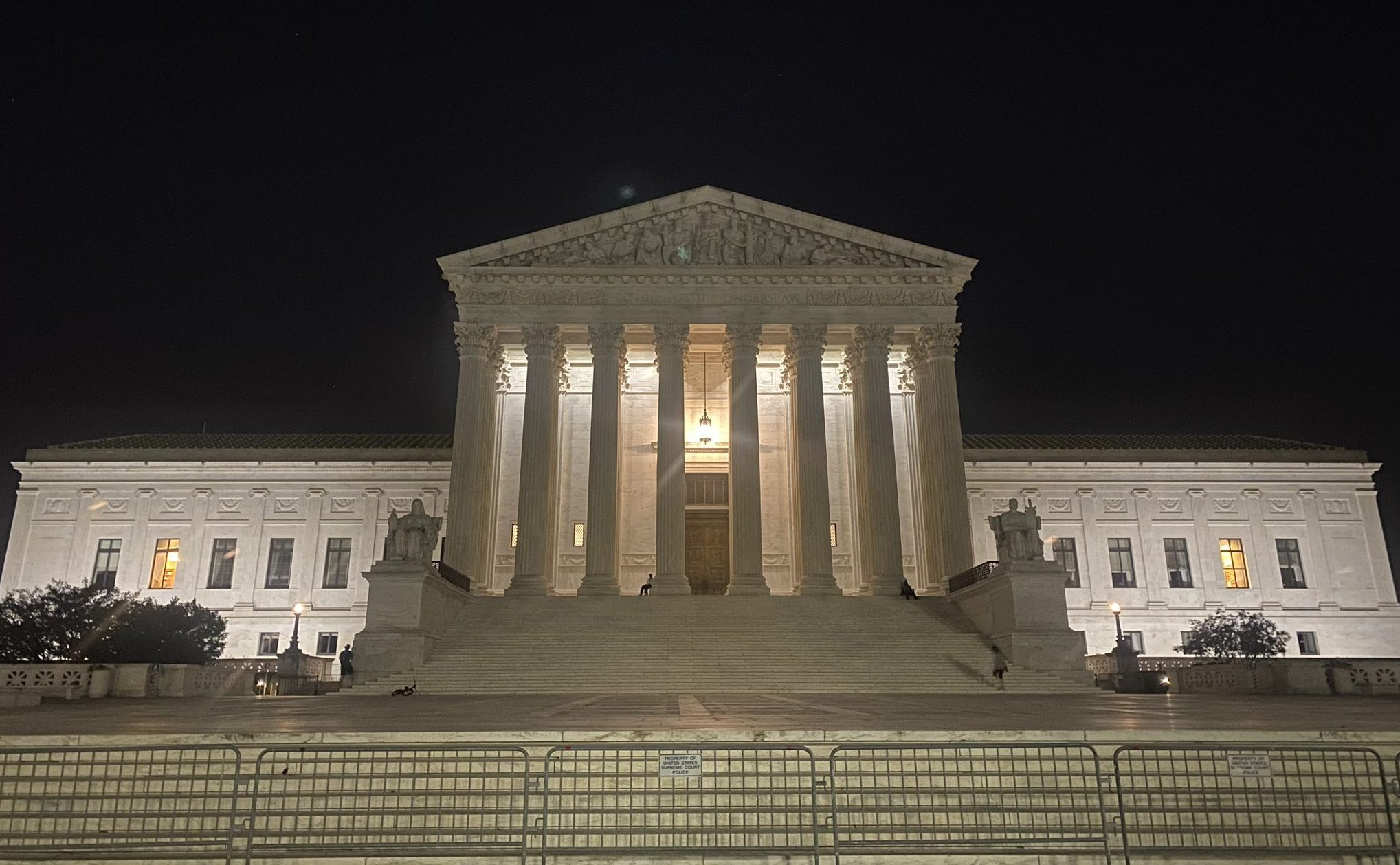 front of Supreme Court lit up at night