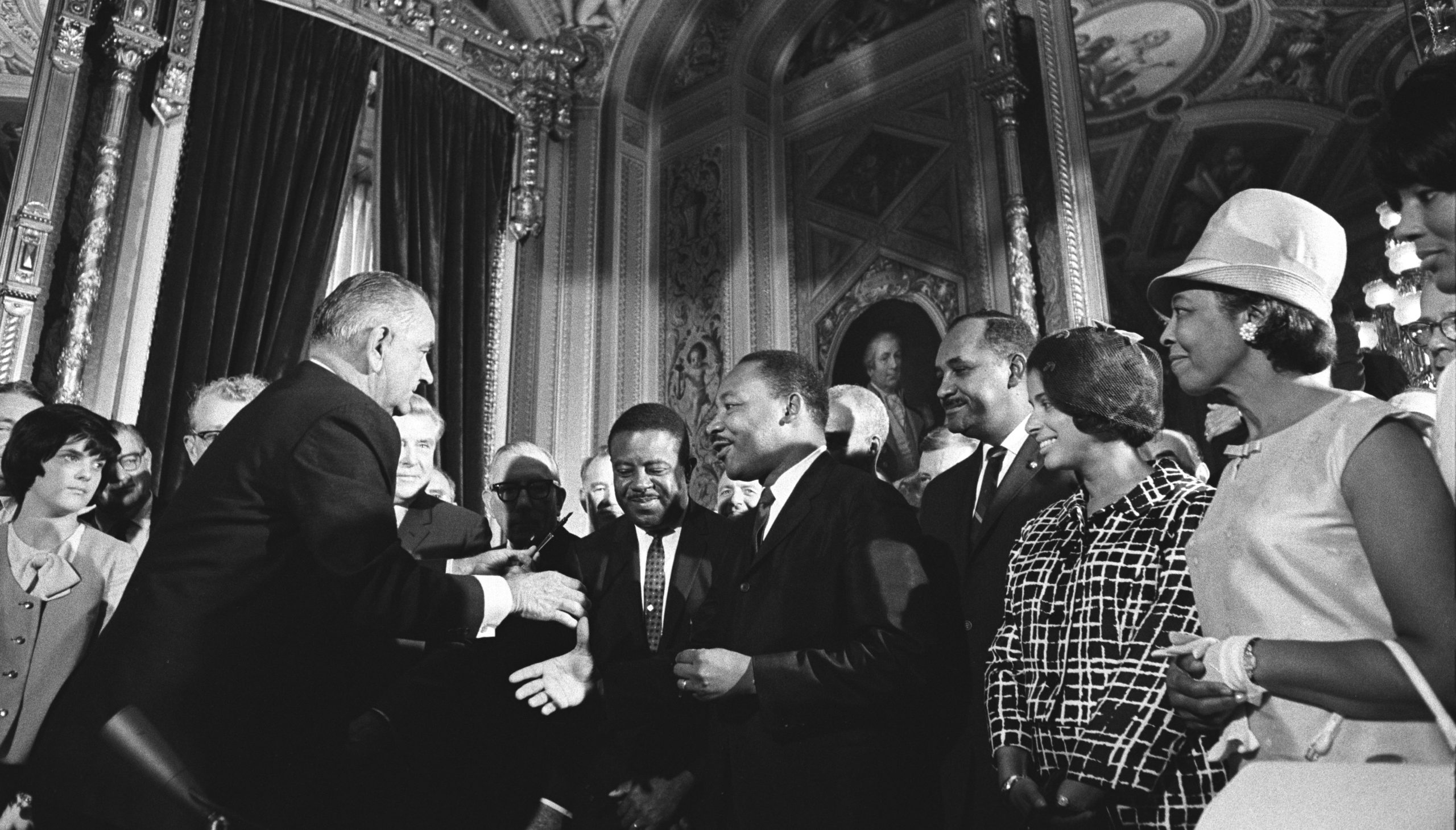 Lyndon Johnson, Martin Luther King Jr. and Rosa Parks among crowd of people