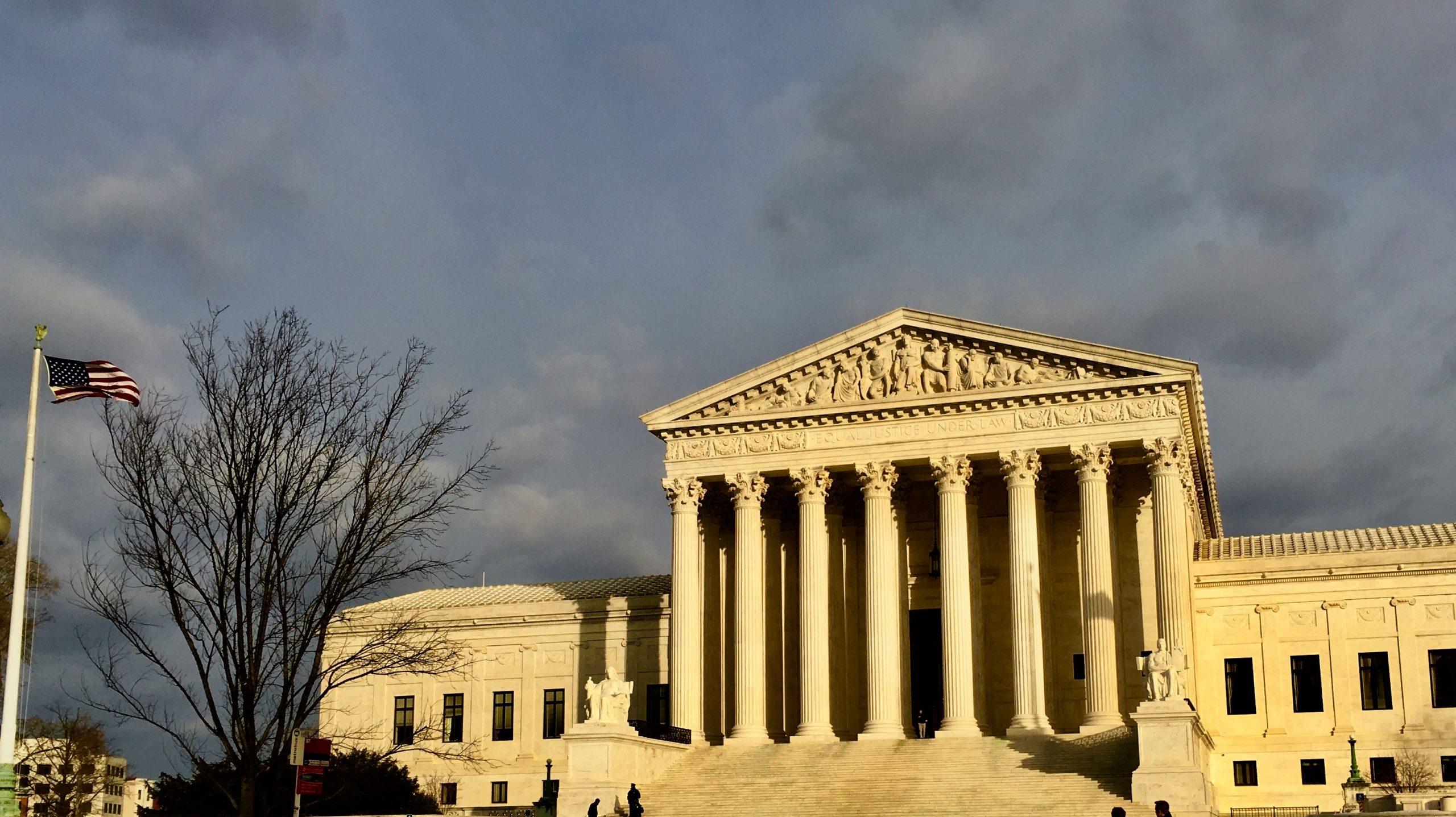 front facade of Supreme Court illuminated in winter sun