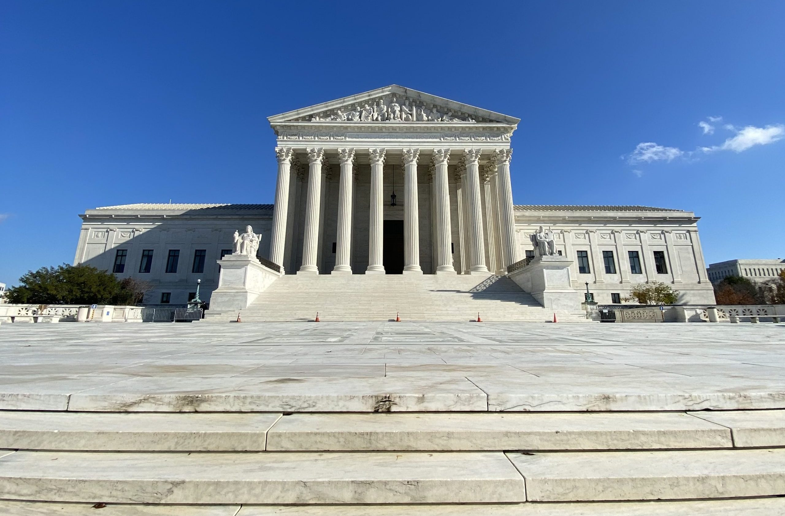 front facade of Supreme Court against blue sky