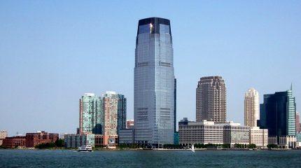 large skyscraper along riverbank