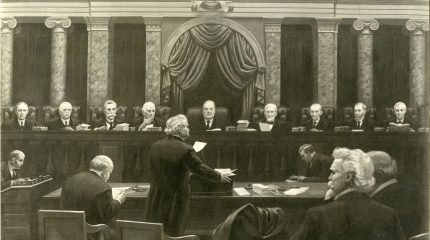 artist's sketch of lawyer in foreground standing and speaking with nine justices listening in background