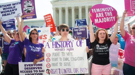 large crowd of women holding signs supporting abortion rights in front of Supreme Court