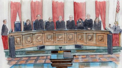 eight justices stand at the bench, only Sotomayor is masked.