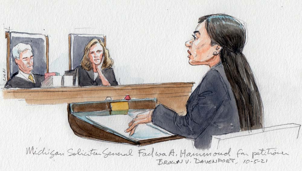 justices Gorsuch and Barrett watch as Michigan solicitor general Fadwa Hammoud speaks for the petitioner in the courtroom