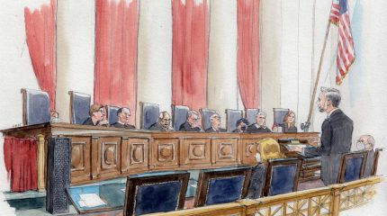 sketch of man at lectern speaking to eight justices sitting behind bench